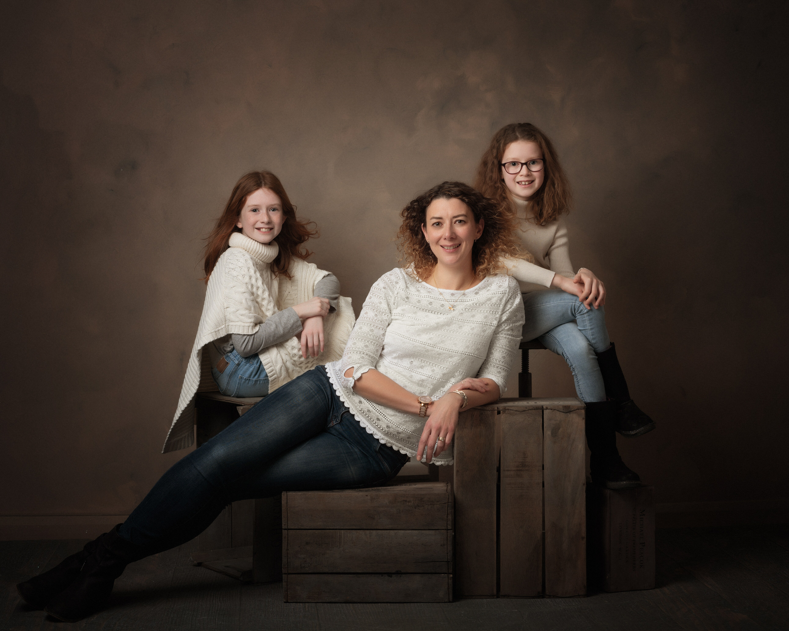 Mum with daughters in studio by Family photographer Lancashire