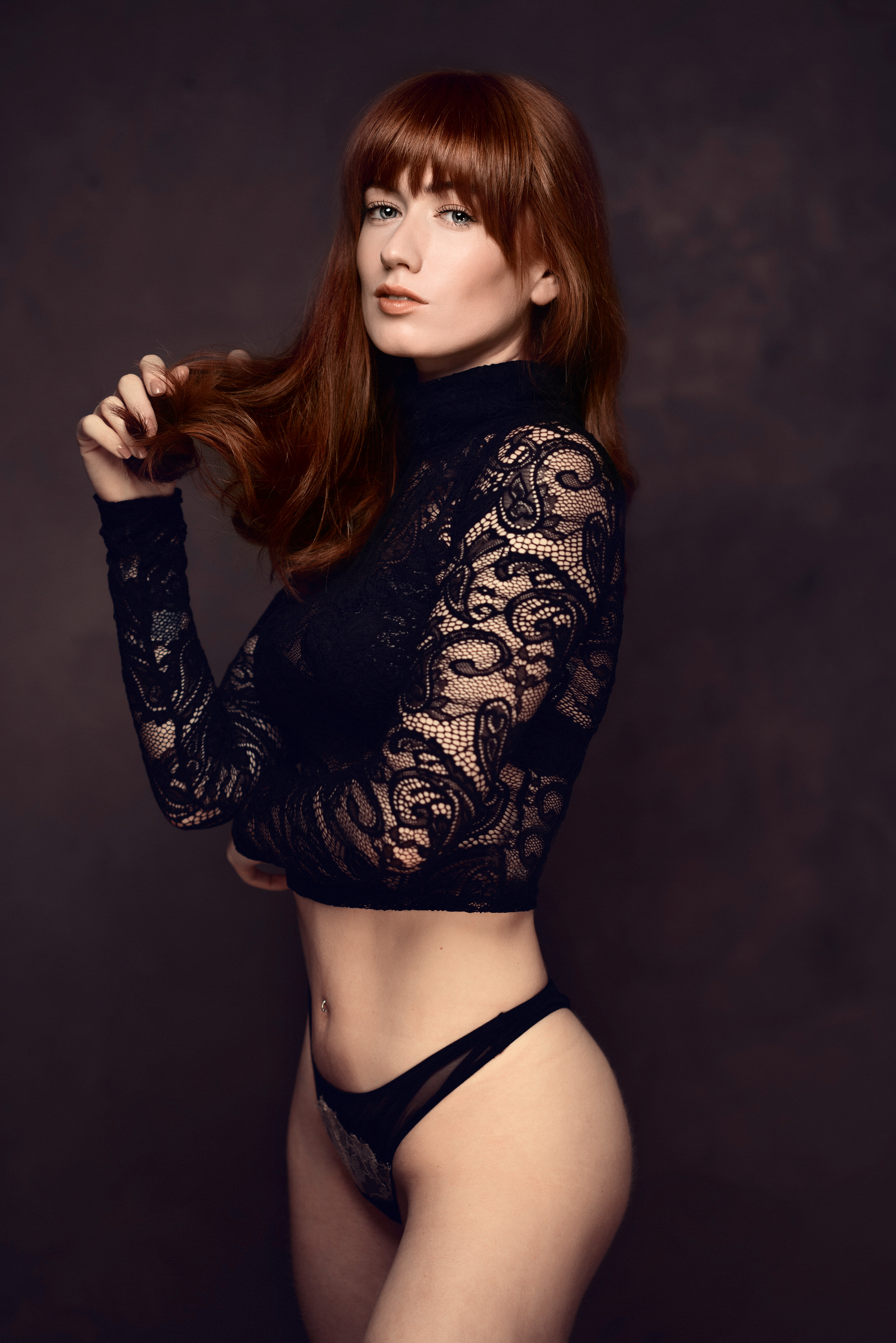 red headed model with black underwear by Boudoir Photographer Lancashire