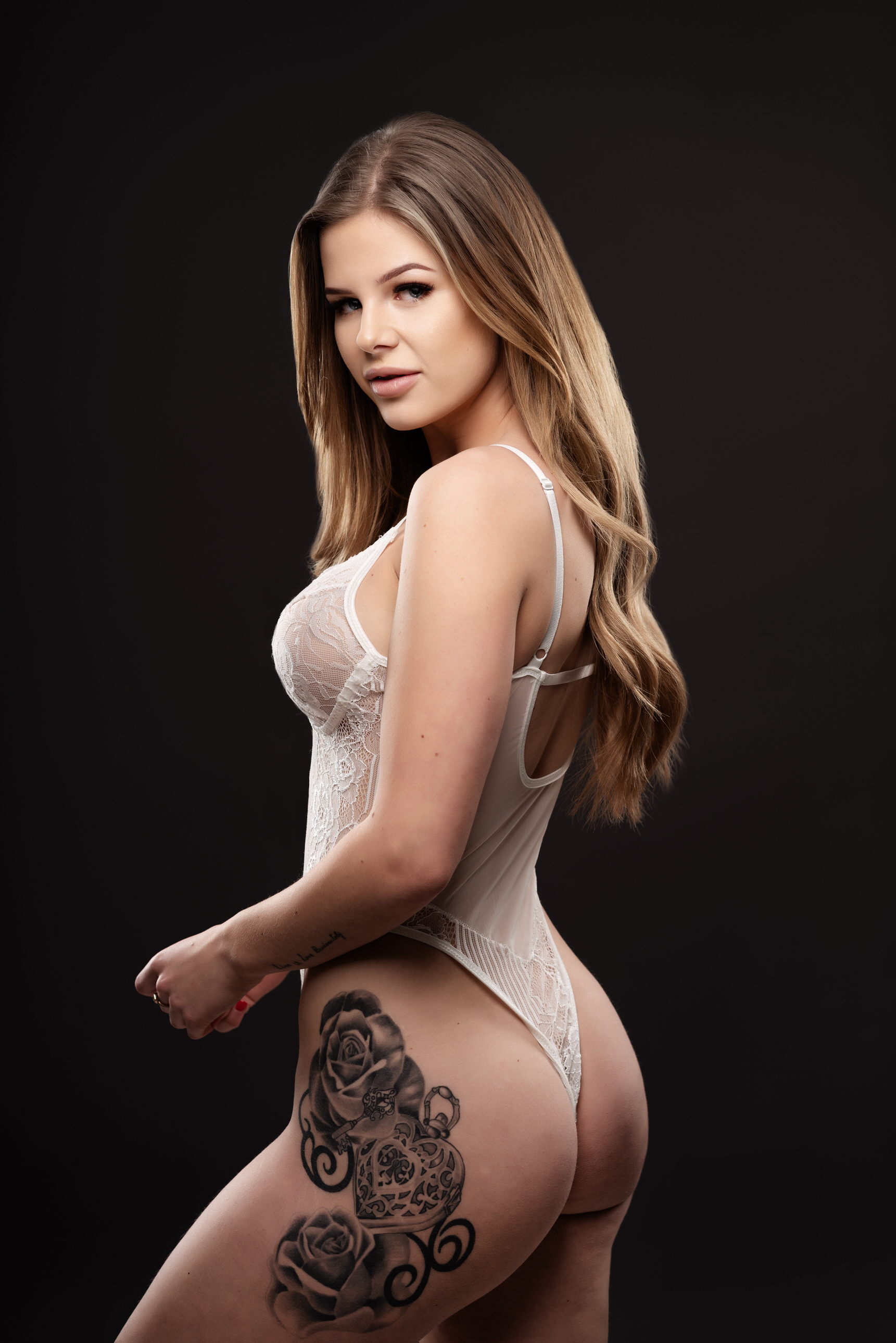 boudoir image of girl in white thing with tattoo on hip by Boudoir Photographer Lancashire