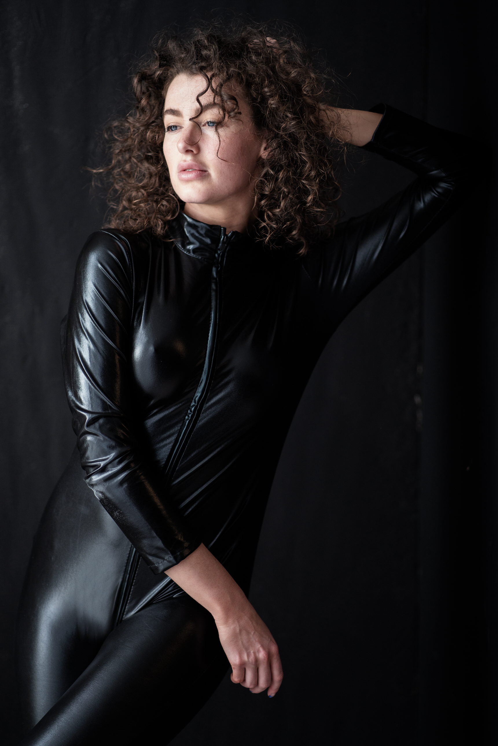 edgu boudoir image girl in black PVC catsuit by Boudoir Photographer Lancashire