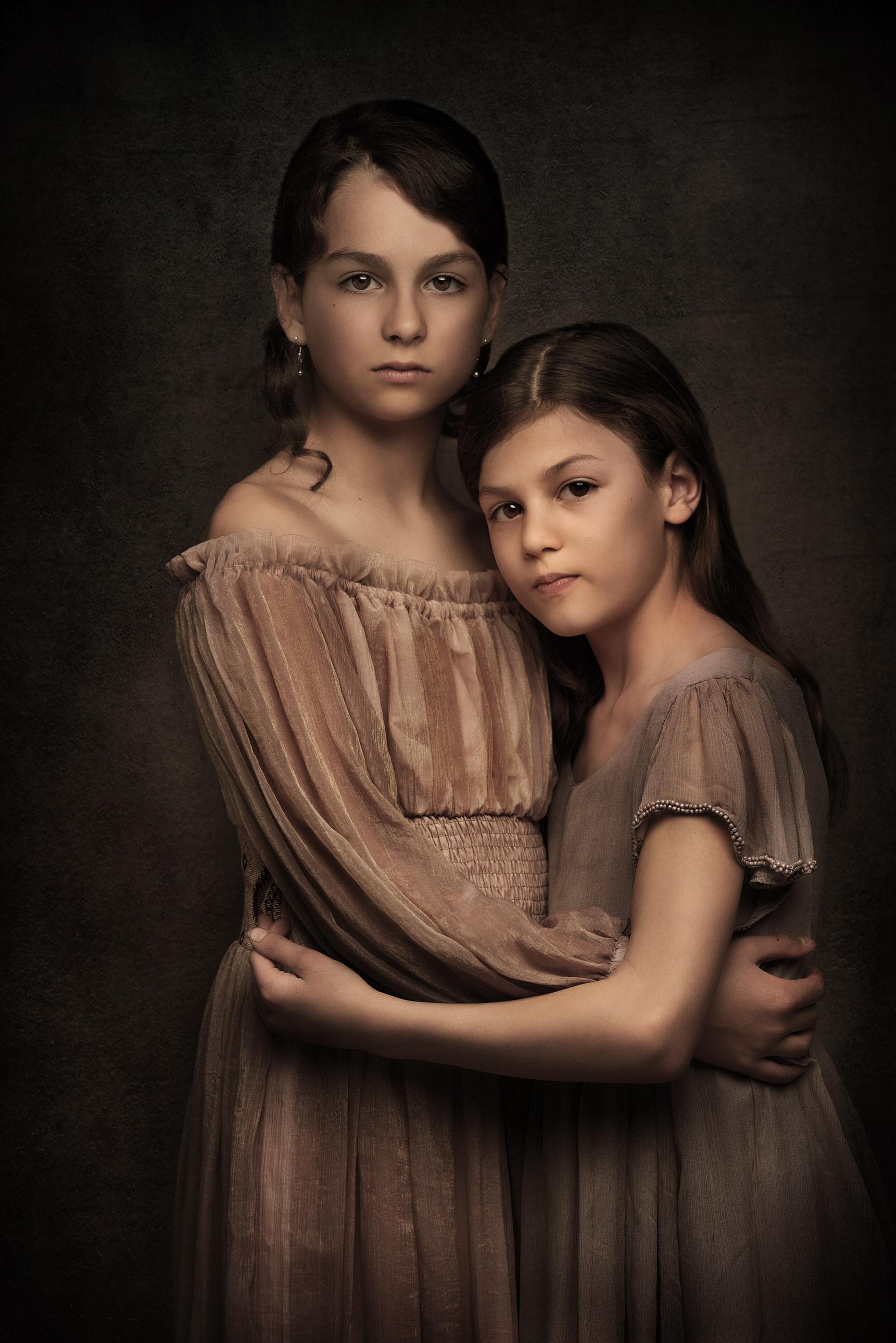 Two girls children in fine art studio by Family photographer Lancashire