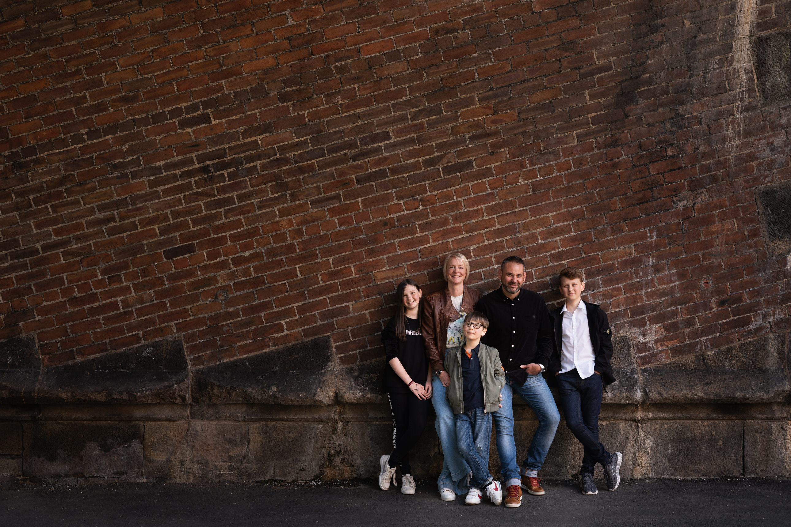 Portrait of family of five on location by family photographer lancashire