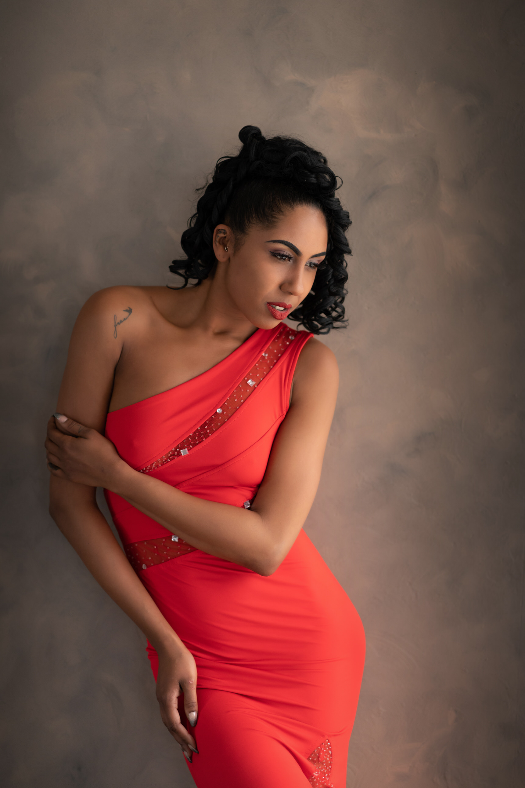 Stunning model in red dress by Boudoir Photographer Lancashire