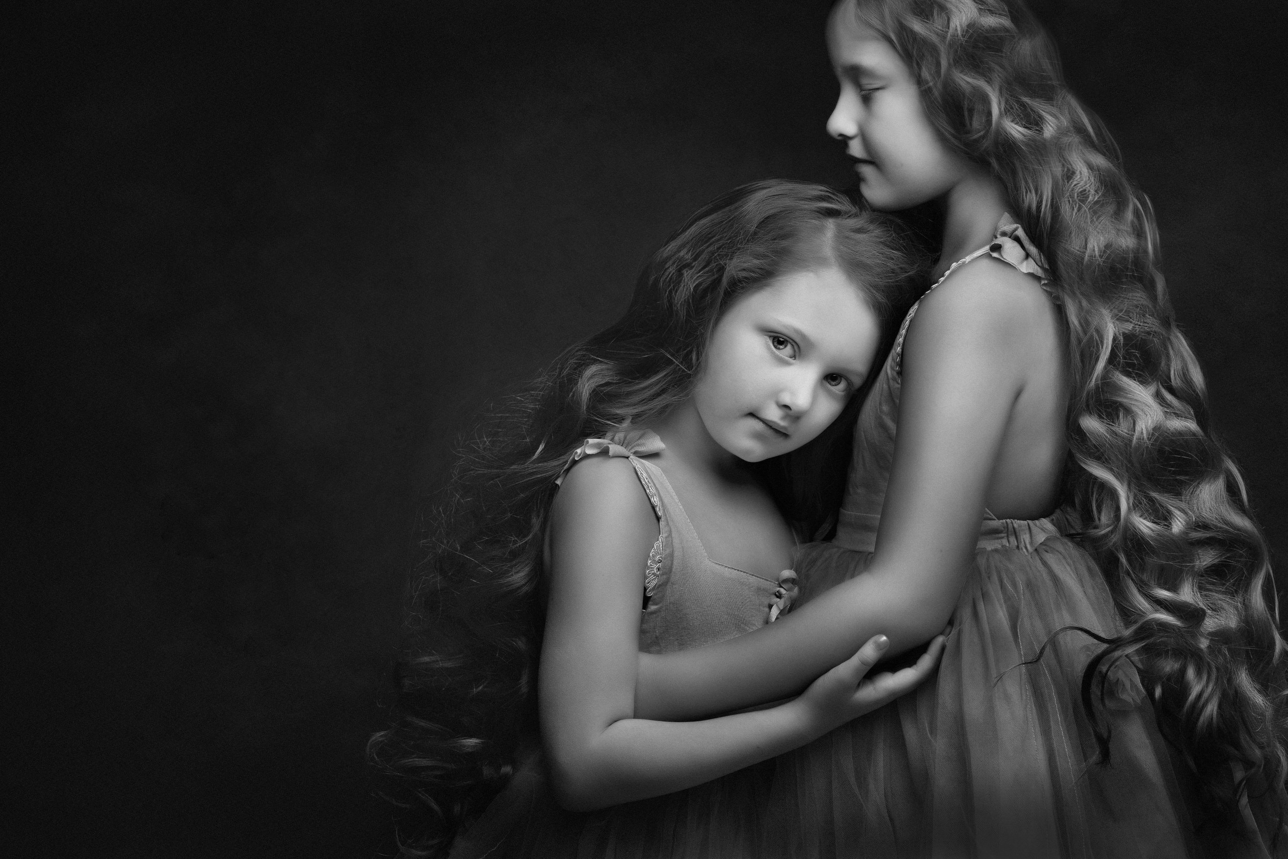 Two girls fine art childrens portrait by Family photographer Lancashire
