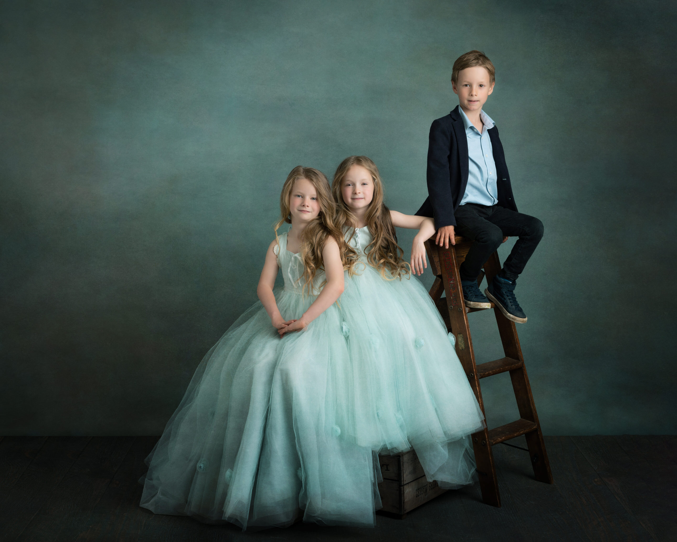 Three children in studio by Family photographer Lancashire