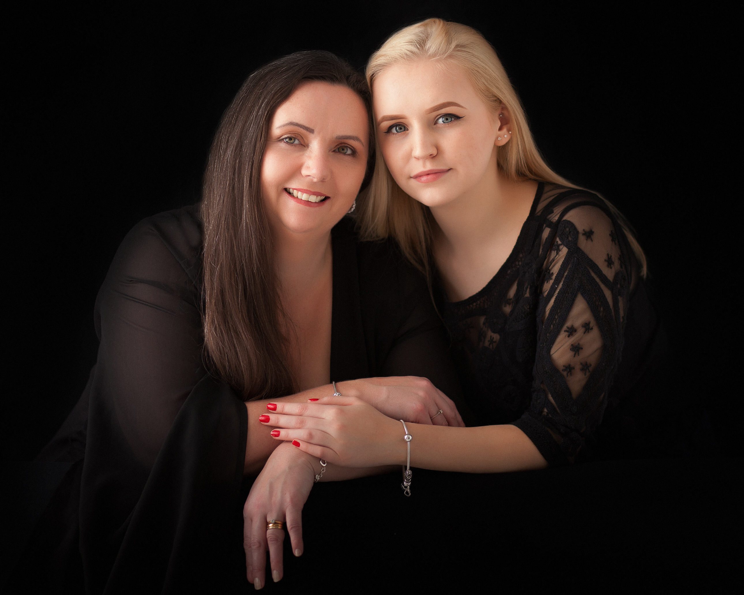 Mum and daughter in studio by Family photographer Lancashire