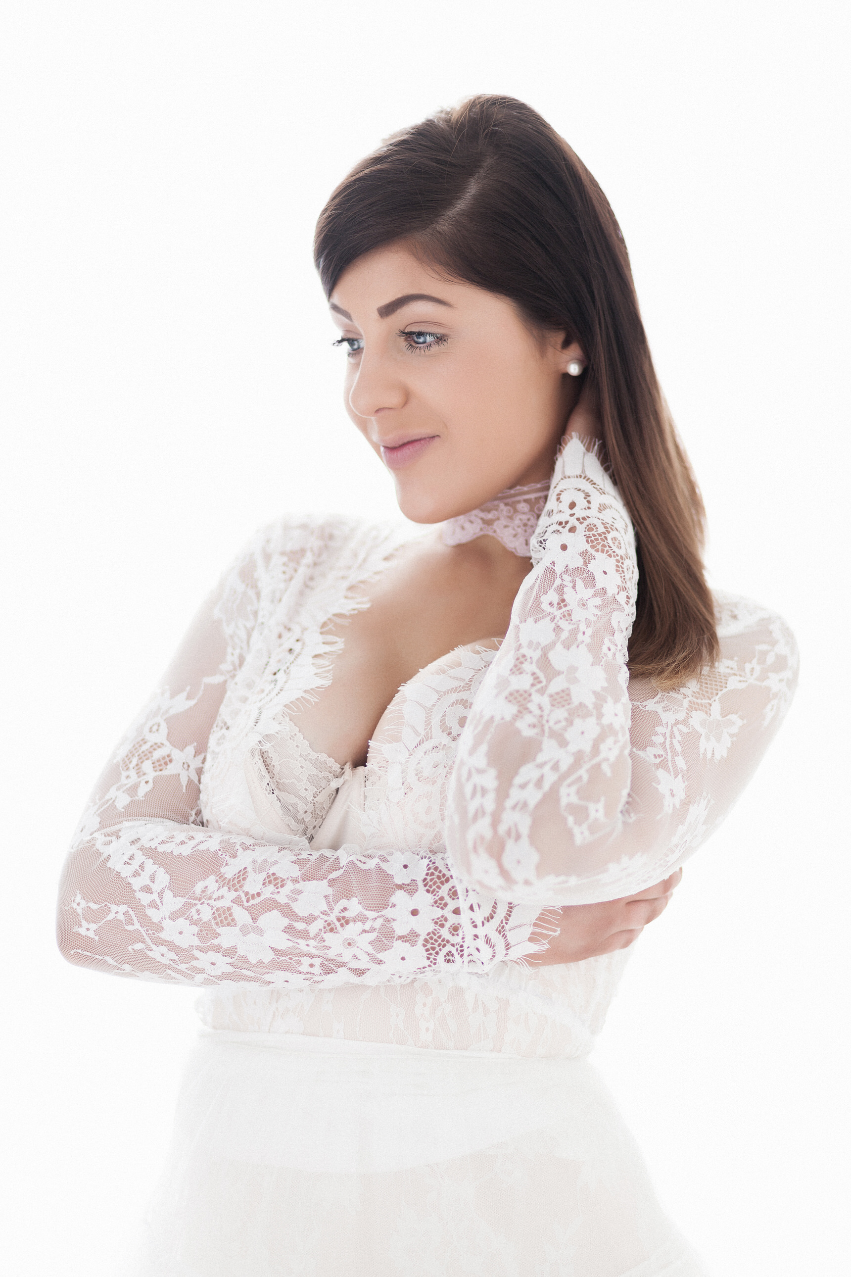 bridal boudoir image white dress and white backgroundBoudoir Photographer Lancashire