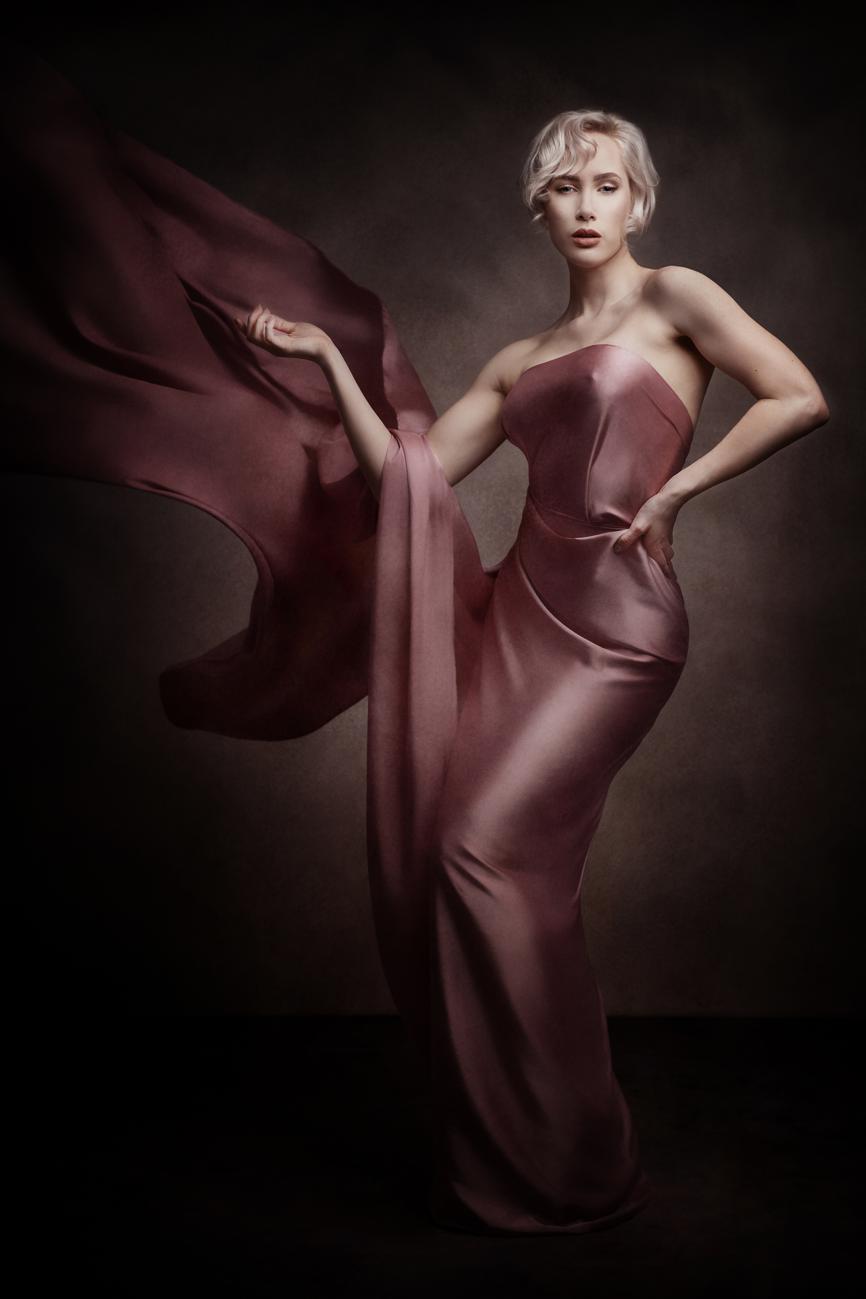 Blonde model in silk fabric by Boudoir Photographer Lancashire