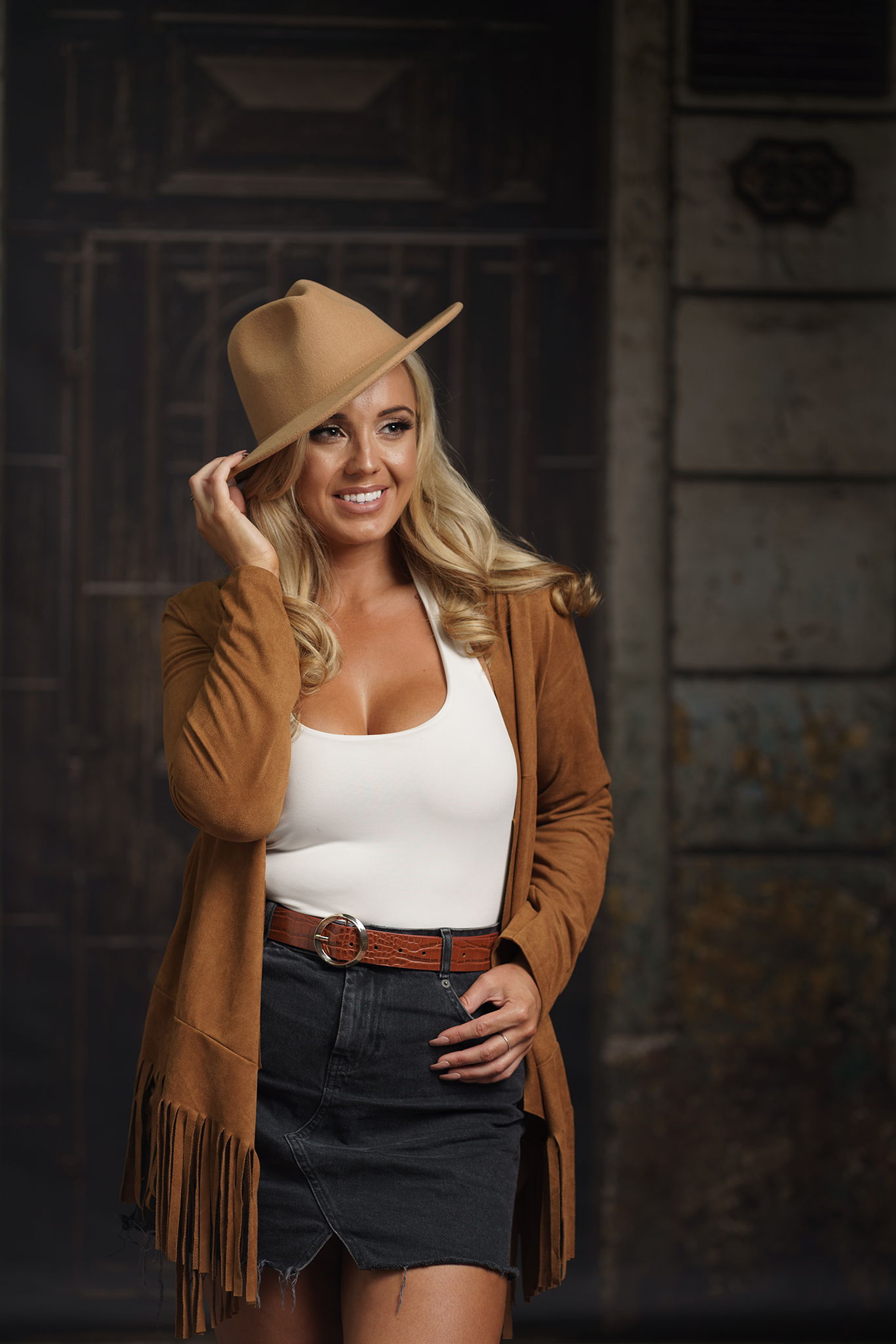 blonde in cowboy hat in studio shoot by Portrait photographer Preston