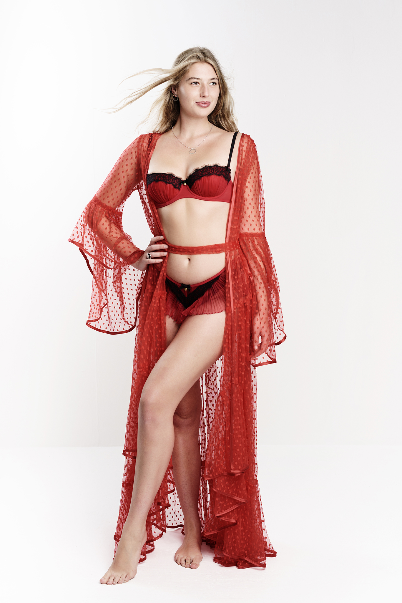 blonde model inderwear shoot in studio wearing red lace