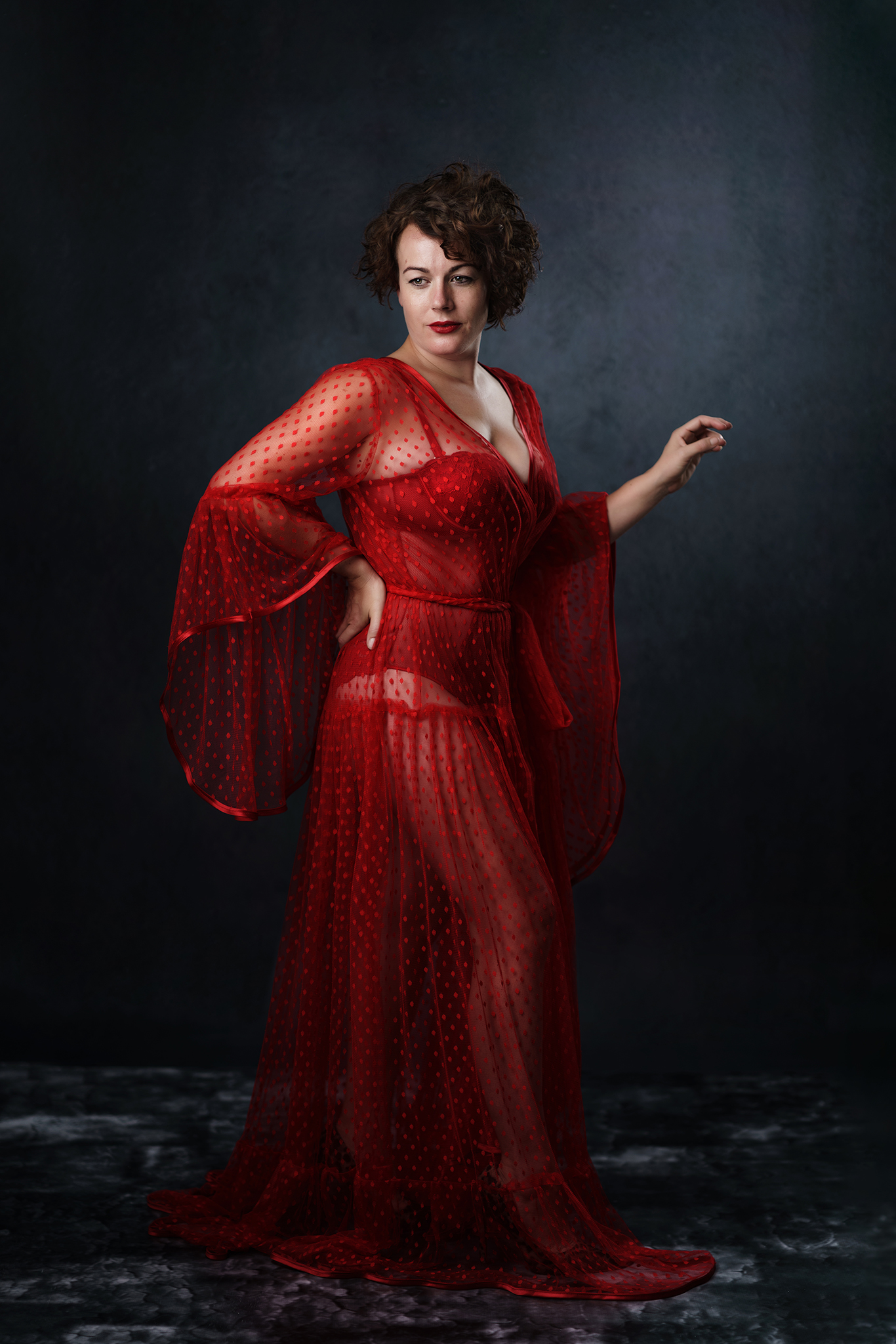 model in red lace dress by Boudoir Photographer Lancashire