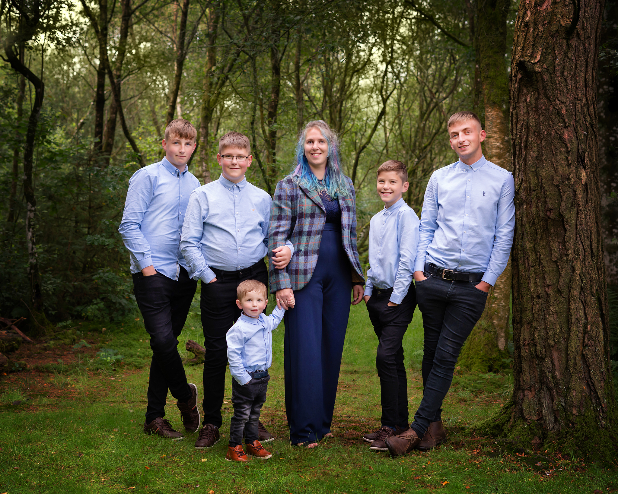 outdoor family photograph family on location in woods by Family photographer Lancashire