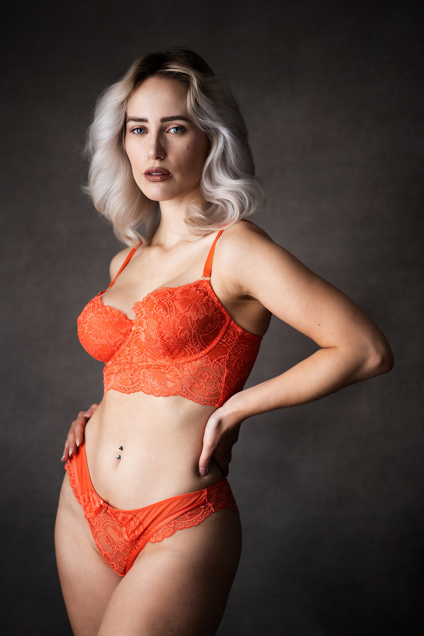 Blonde model in red underwear in studio portrait by Boudoir Photographer Lancashire