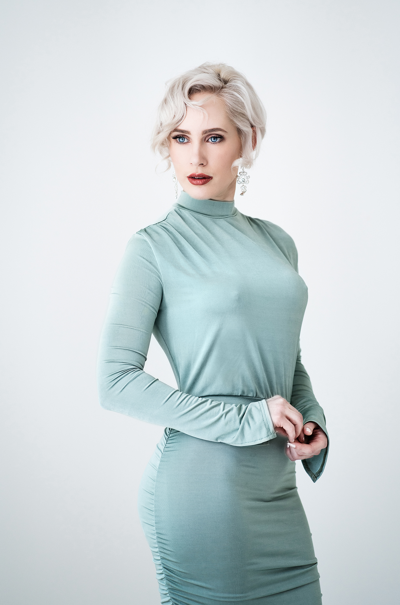 blonde model in green dress by Portrait photographer Preston
