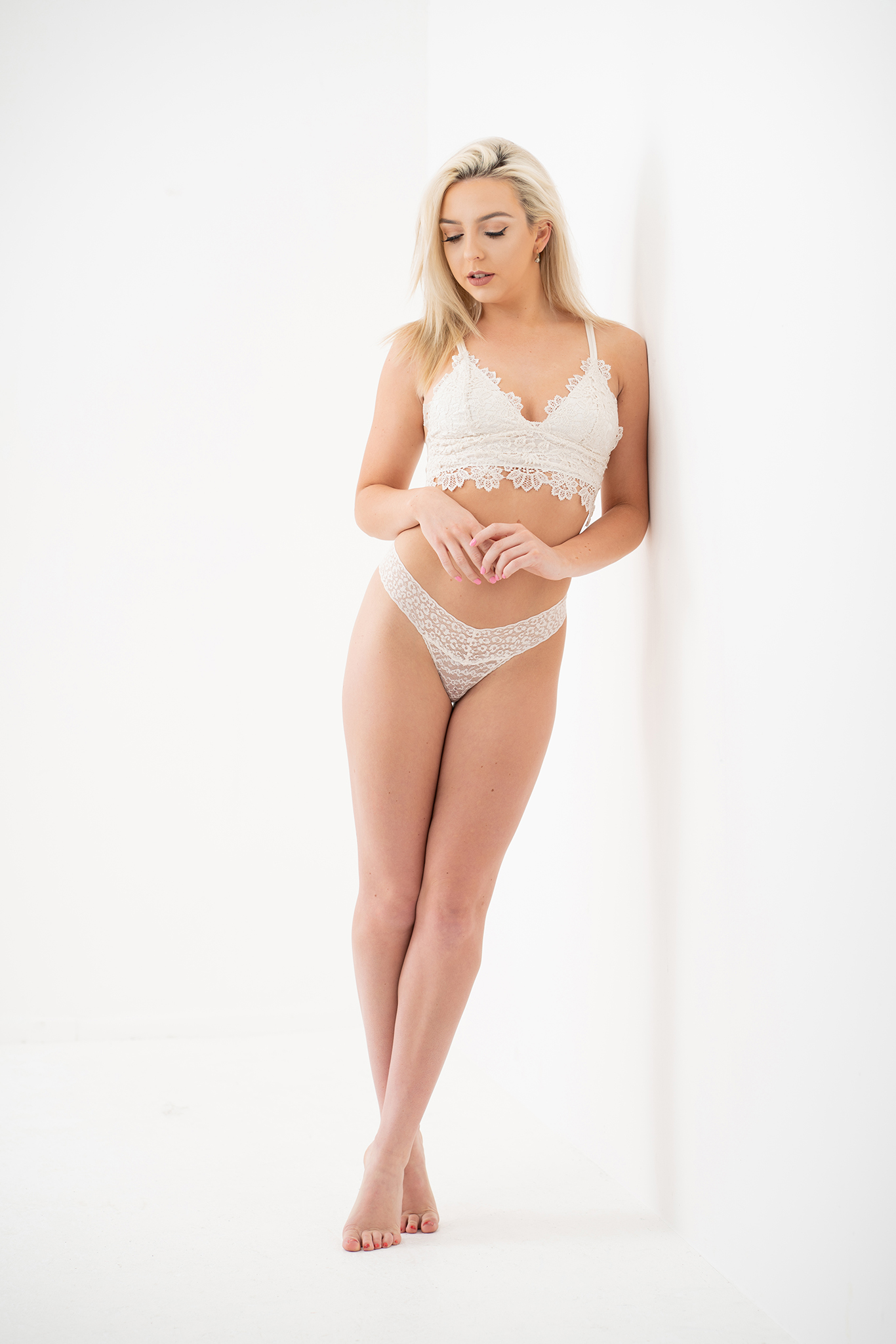 blonde model in white underwear by Boudoir Photographer Lancashire