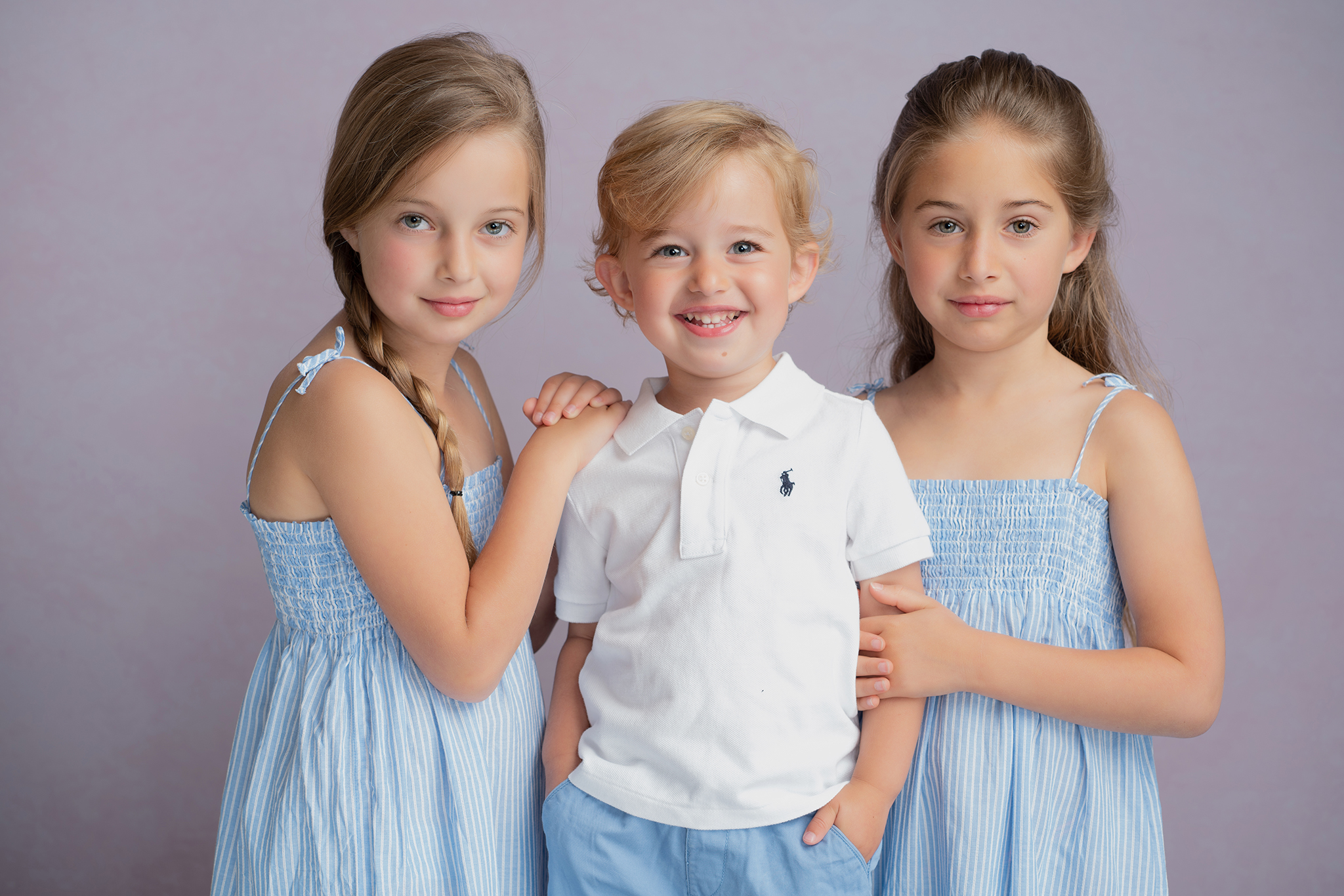 three children two sisters and brother children portrait by Family photographer Lancashire