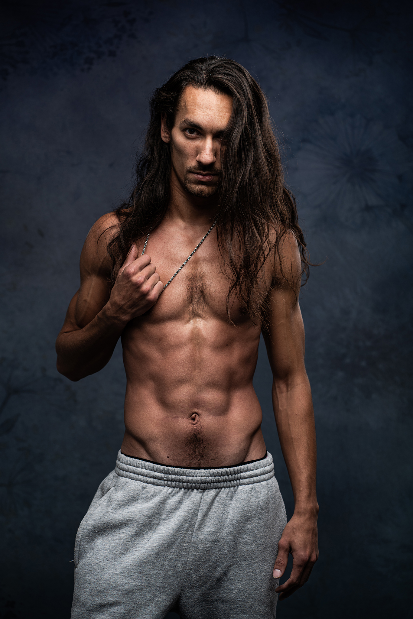 male model portfolio fitness model topless in studio moody lighting by Portrait photographer Preston