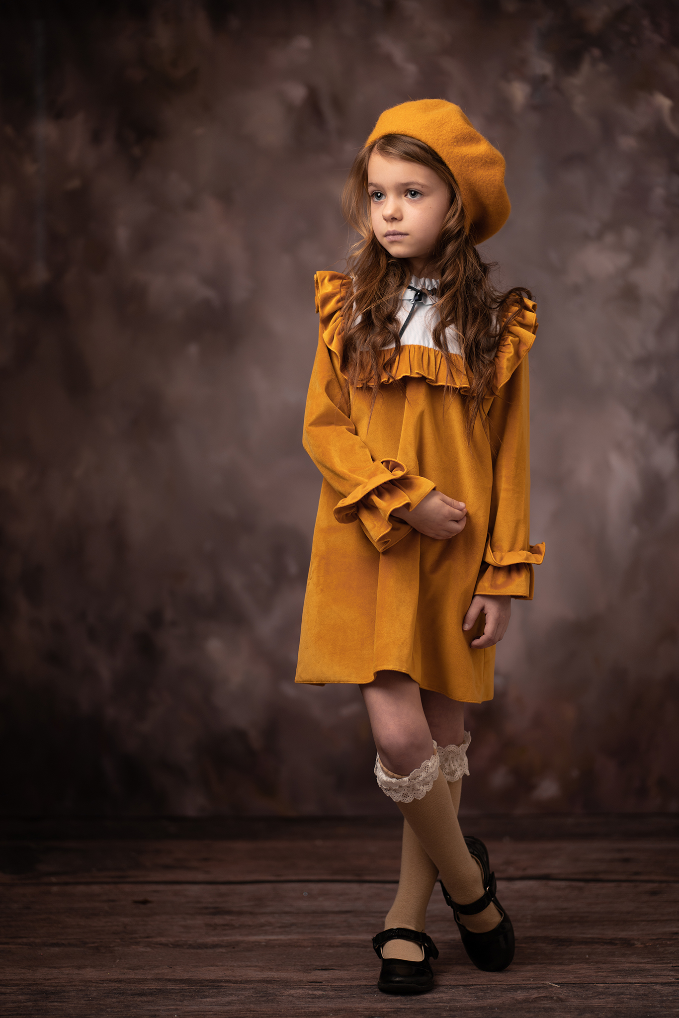 Young girl in vintage yellow outfit studio photograph by Family photographer Lancashire