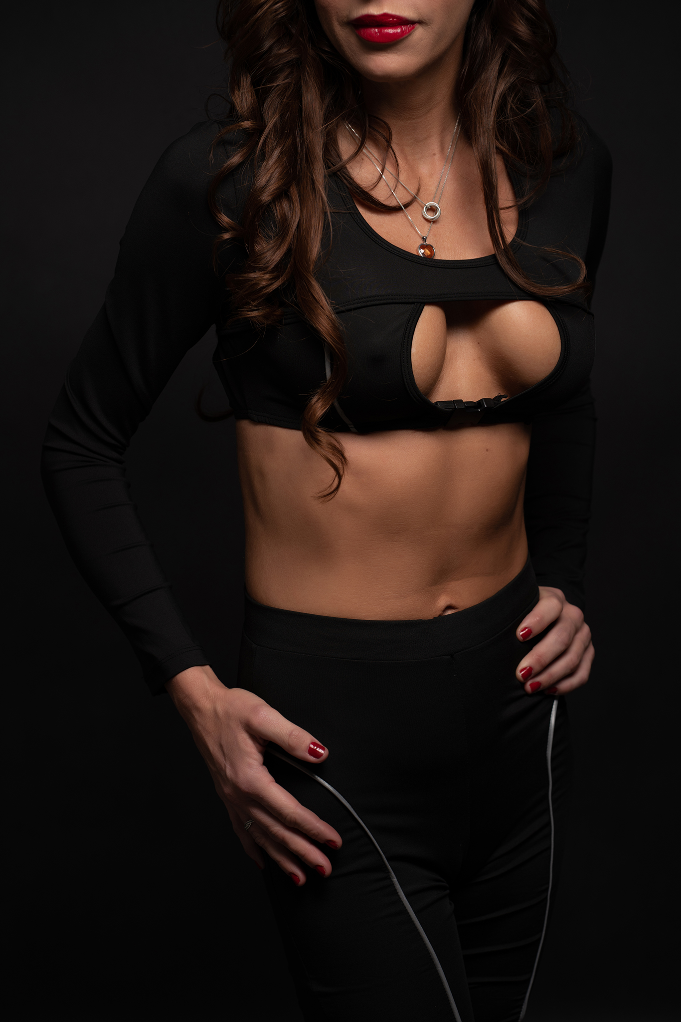 sporty toned woman in studio portrait by Boudoir Photographer Lancashire