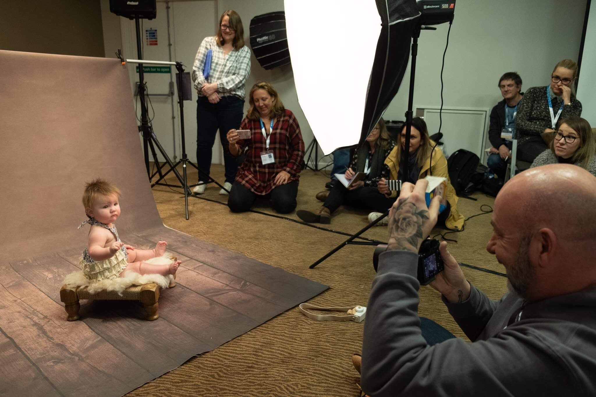 group workshop with baby and one light in Studio lighting training