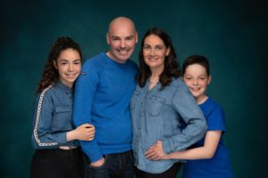 family with kids dressed in blue photographed by family photographer in preston lancashire