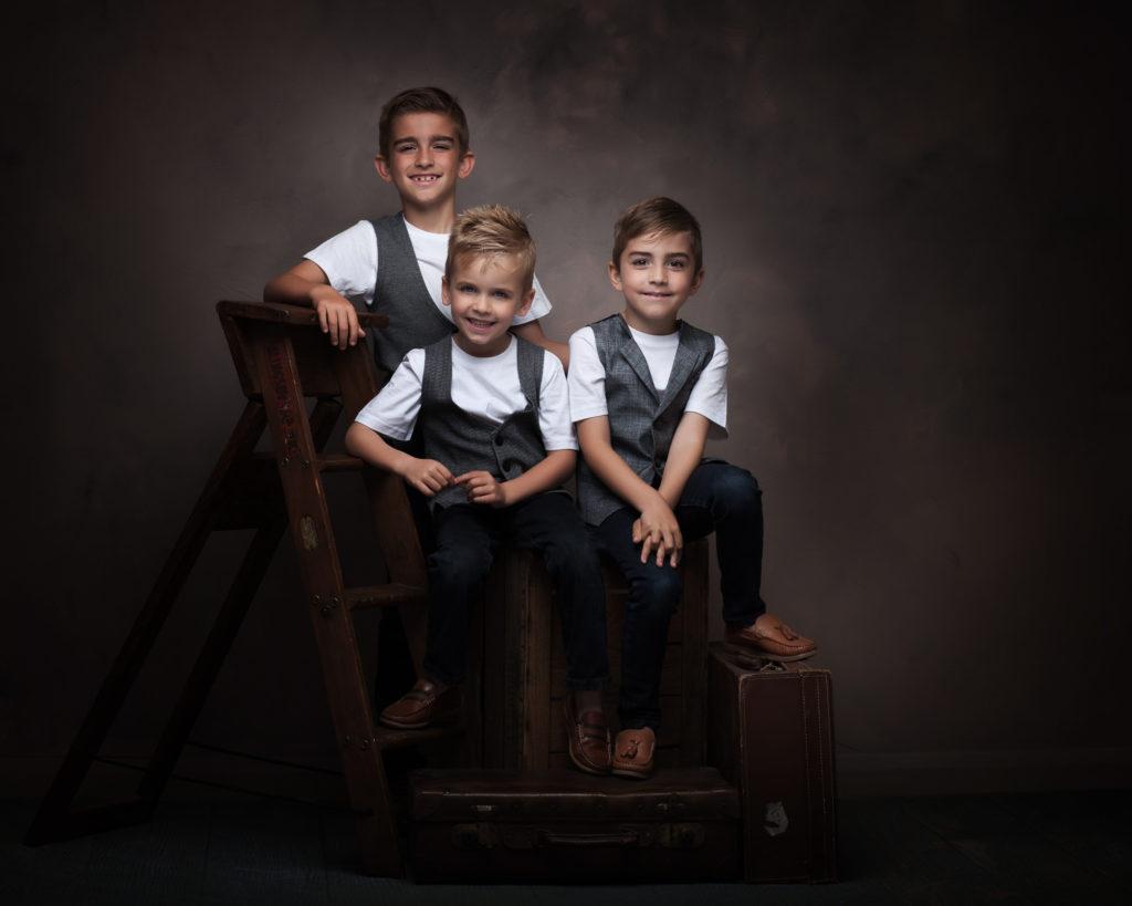 three boys in photo studio by Family photographer in preston lancashire