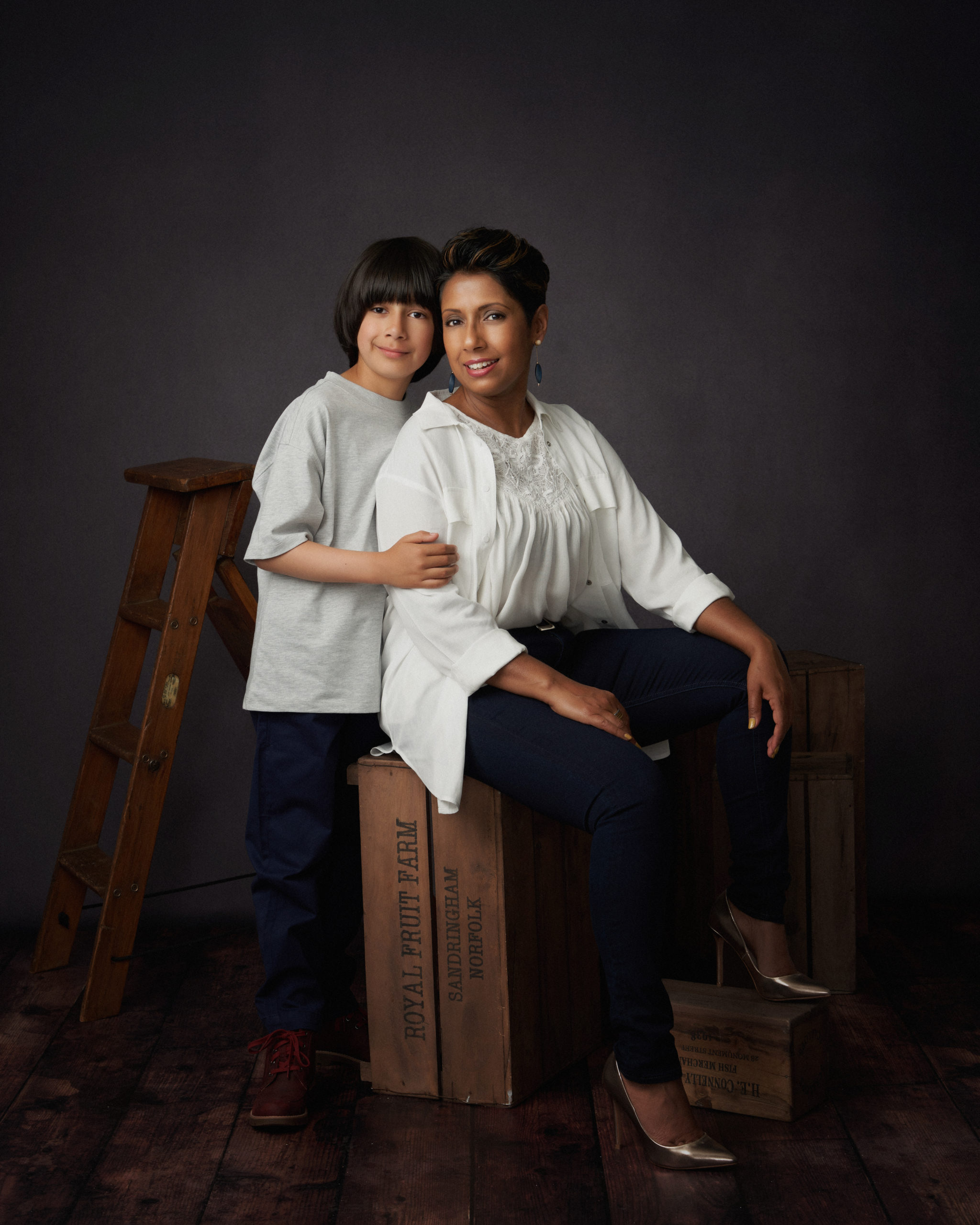 mum and son on dark background photography studio by Family photographer in preston lancashire