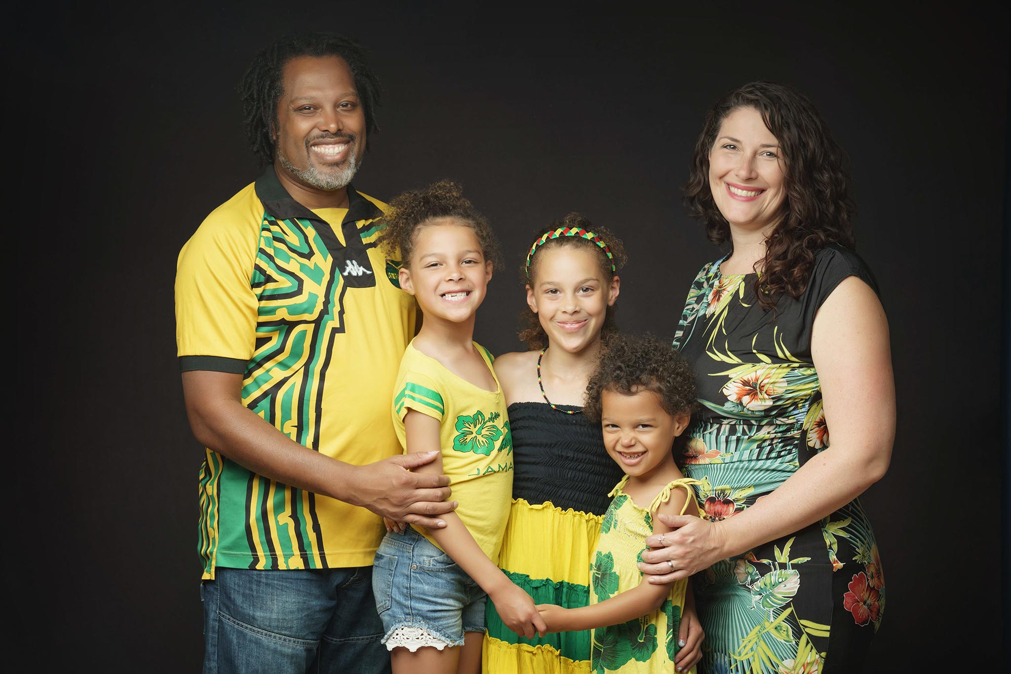 family in bright yellow with three daughters by Family photographer Lancashire