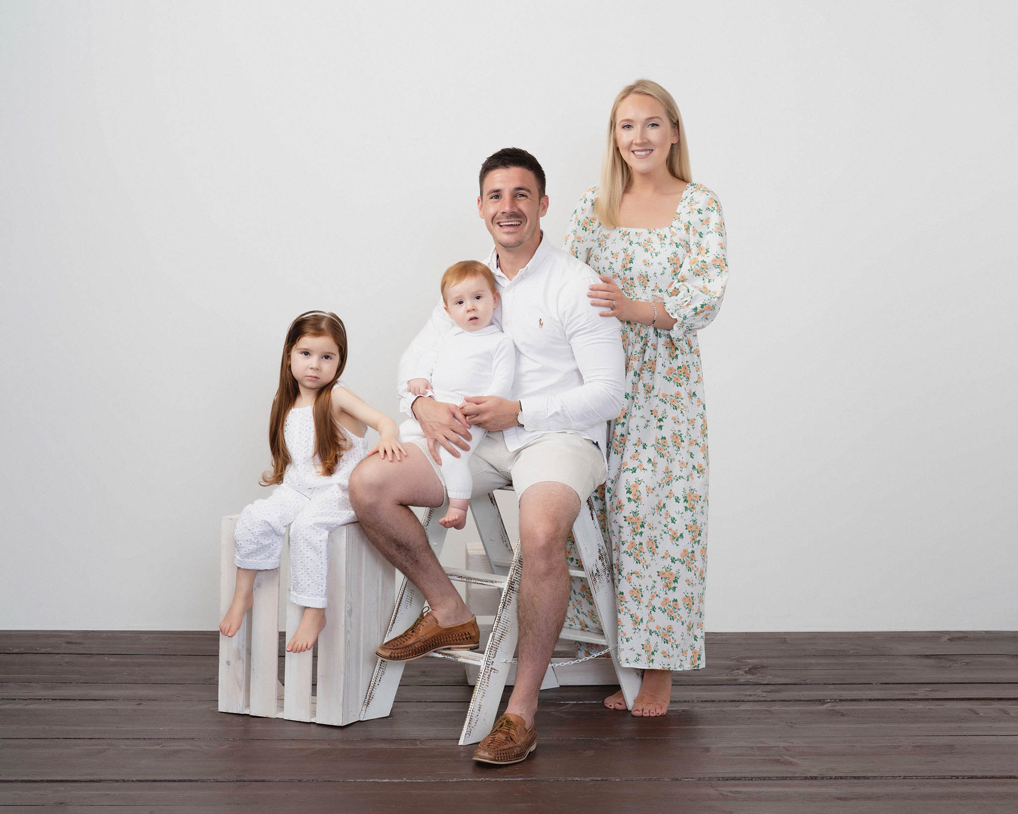 family of parents and two children wearing white photographed by Family photographer Lancashire
