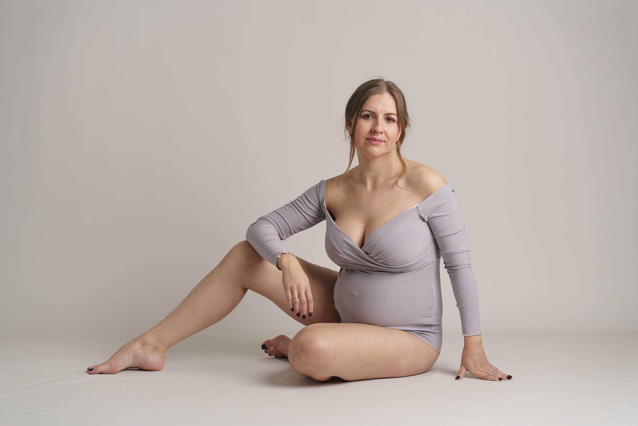 pregnant mum in bodysuit on white by Family photographer Lancashire